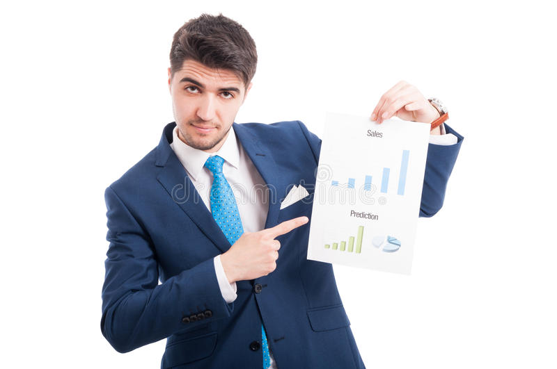 Charming entrepreneur or salesman showing his charts. With sales and prediction and pointing to them isolated on white background stock images