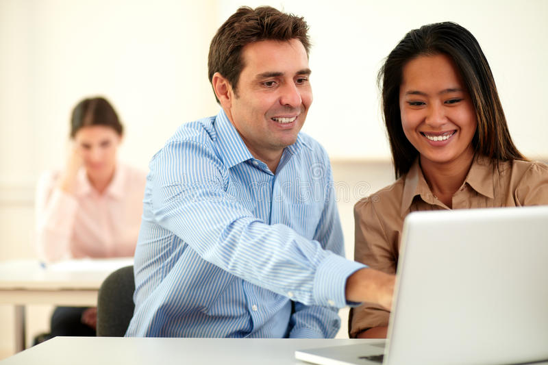 Charming ethnic couple working on laptop royalty free stock image