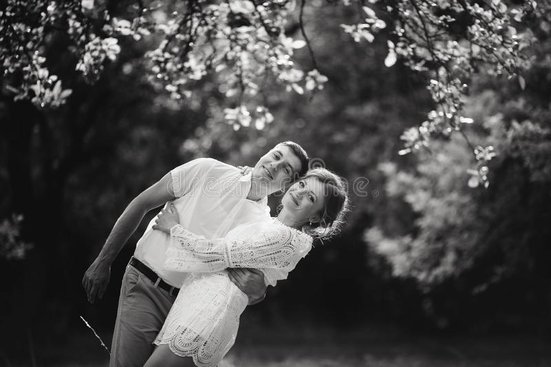 Charming and fashionable couple in love background old vintage castle. Black and white royalty free stock image