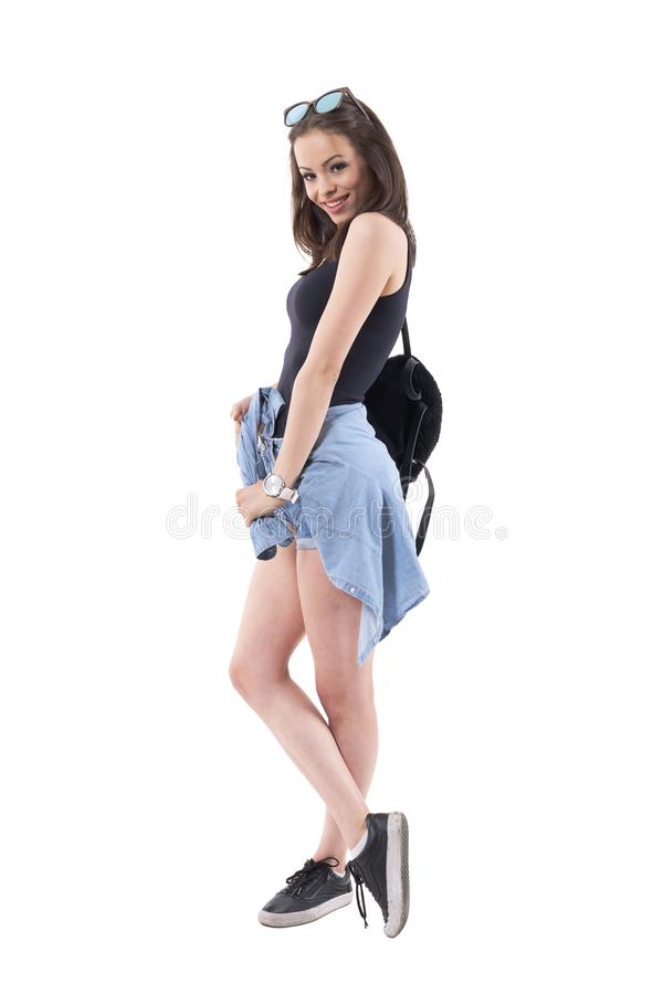 Charming flirty playful young stylish woman looking at camera over shoulder like sideway glance. stock image