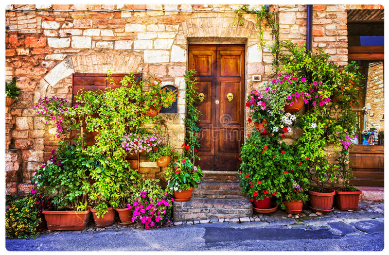 Charming floral decorated streets of medieval towns of Italy. Sp royalty free stock images