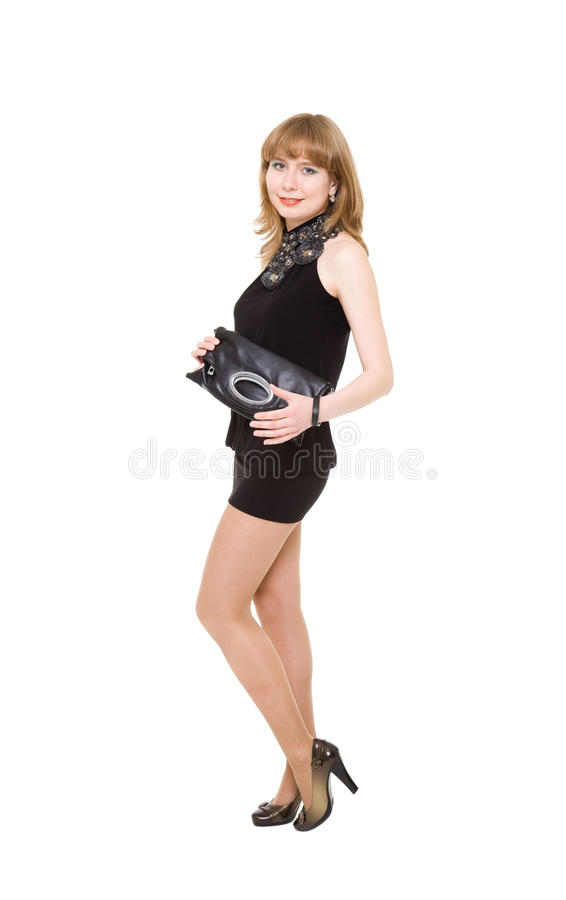 Charming girl in a black short dress royalty free stock photography
