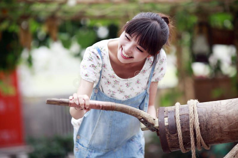 Charming girl enjoying farm life. Charming city girl enjoying the fun of farm life royalty free stock photo