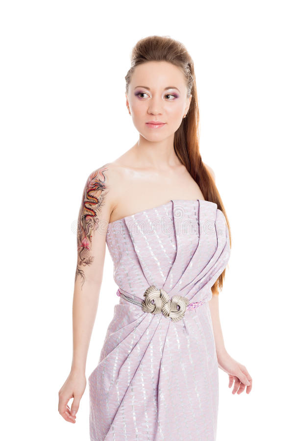 Charming girl in a lilac dress stock photo