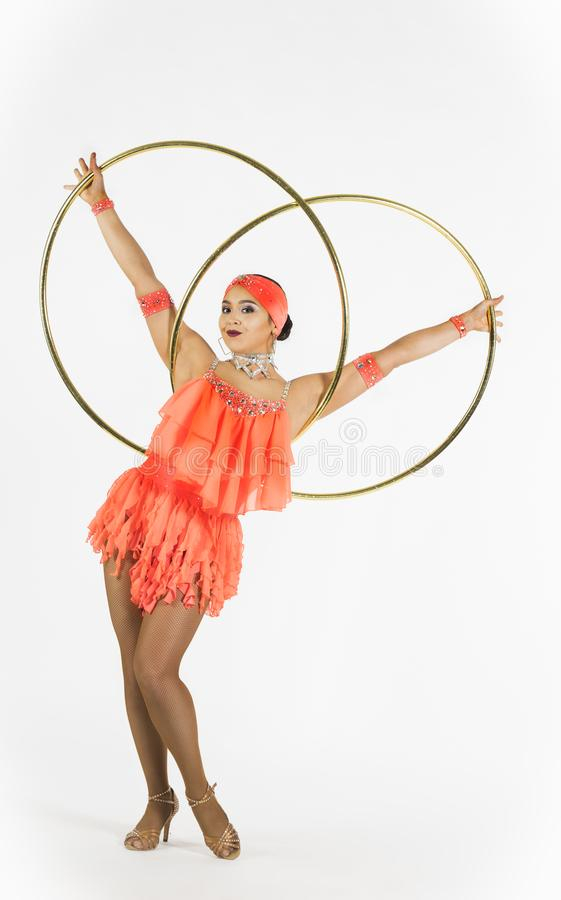 A charming girl performs circus elements with a hula Hoop stock photos