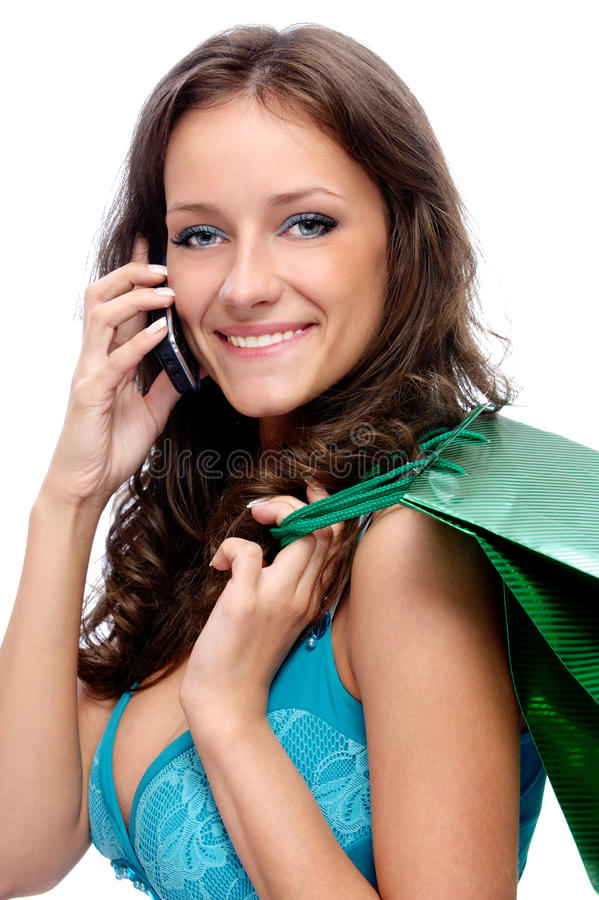 Download Charming Girl With Purchases Speaks Stock Photo - Image: 15618194