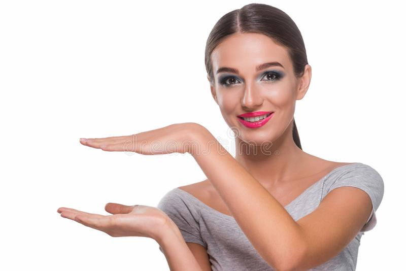 Charming girl showing something royalty free stock images
