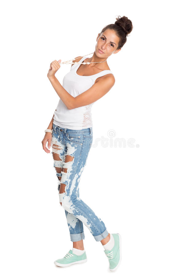 Charming girl in stylish ripped jeans stock photography