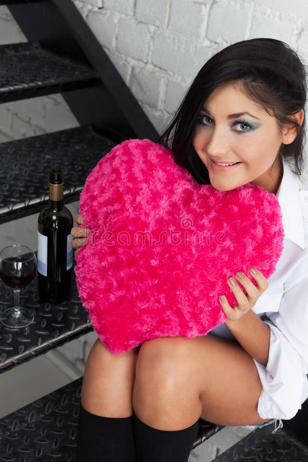 Wine, love and other consequences. Charming girl is waiting for man to come with man and love and other consequences stock image