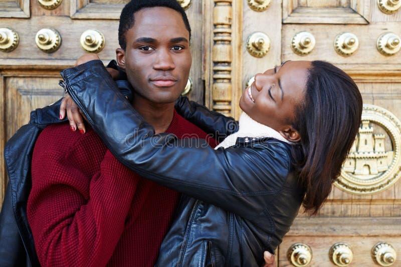 Charming girlfriend embracing her boyfriend during vacation travel on honeymoon stock image