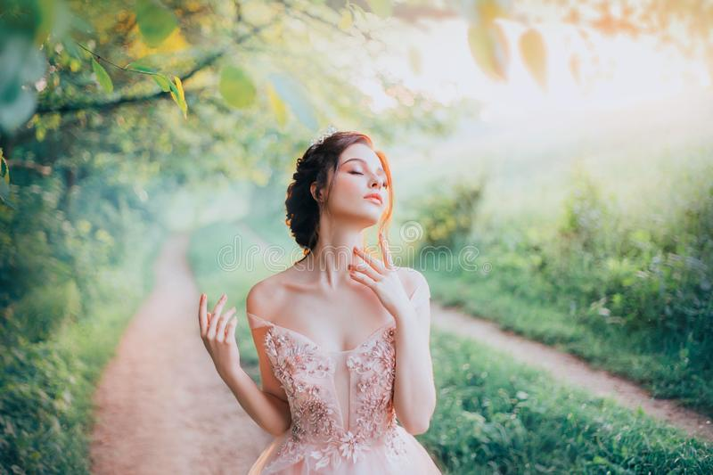 Charming goddess of the spring forest stands on a narrow path and breathes royalty free stock photos