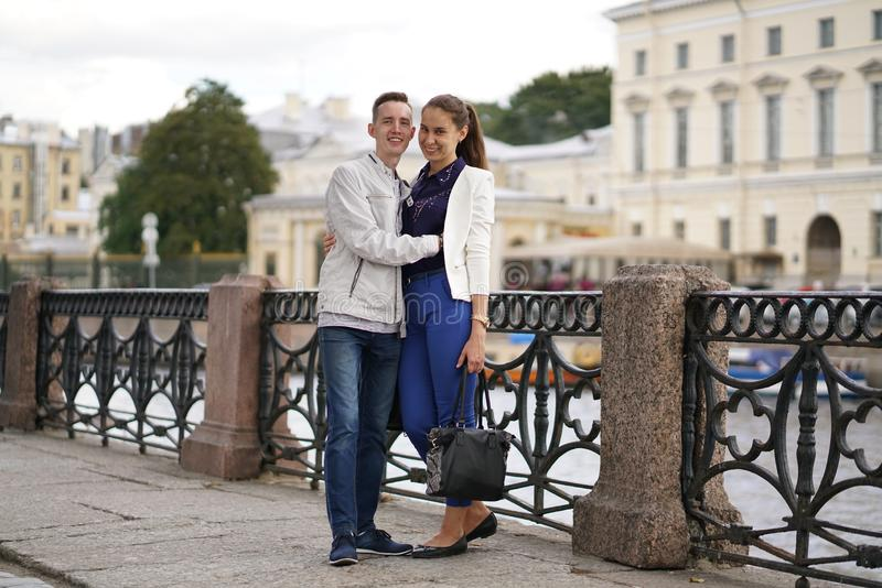 Charming good couple husband and wife walking around the city, hugging and spending time with love. Together royalty free stock photos