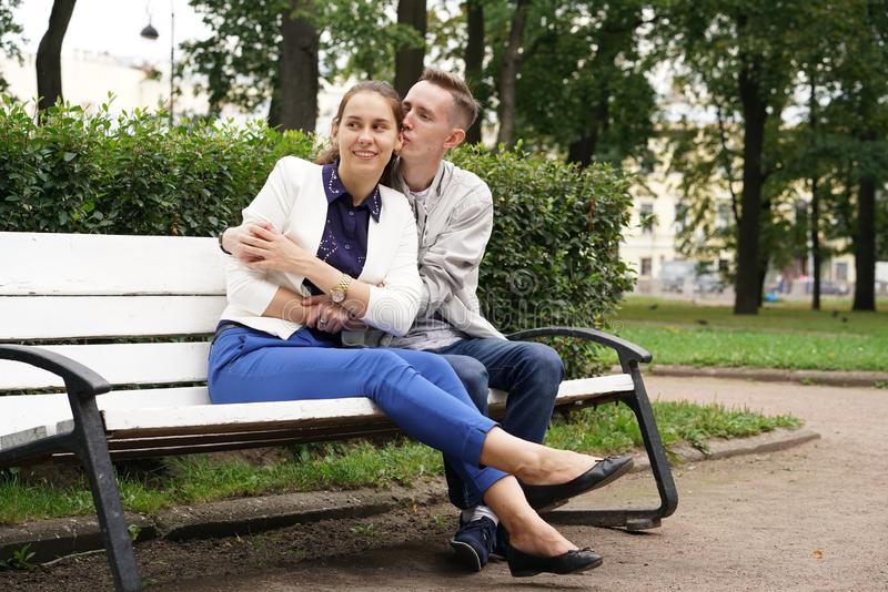 Charming good couple husband and wife walking around the city, hugging and spending time with love. Together royalty free stock images