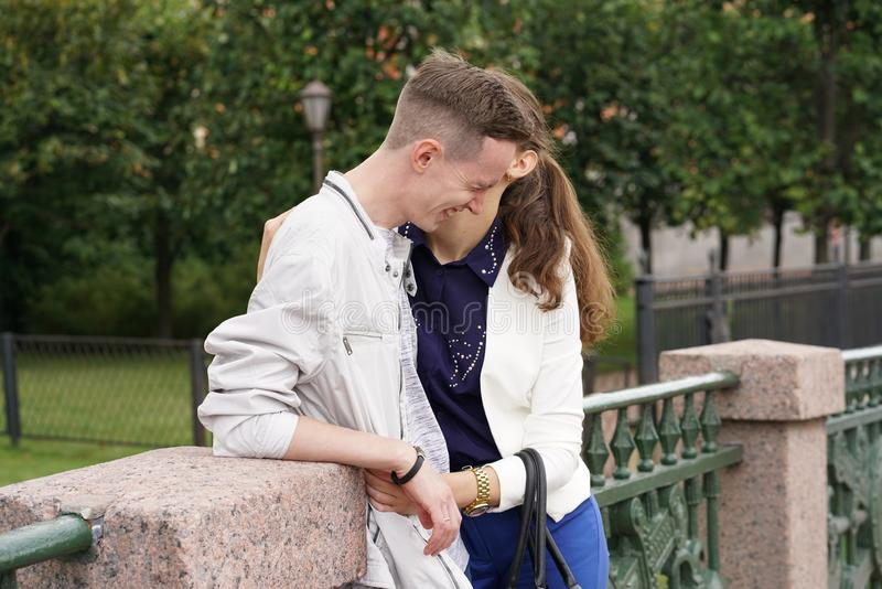 Charming good couple husband and wife walking around the city, hugging and spending time with love. Together stock photography