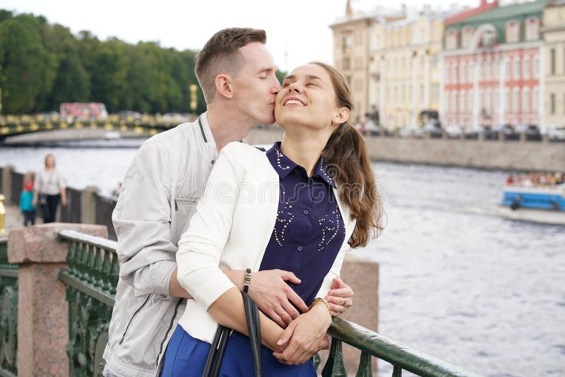 Charming good couple husband and wife walking around the city, hugging and spending time with love. Together royalty free stock photo