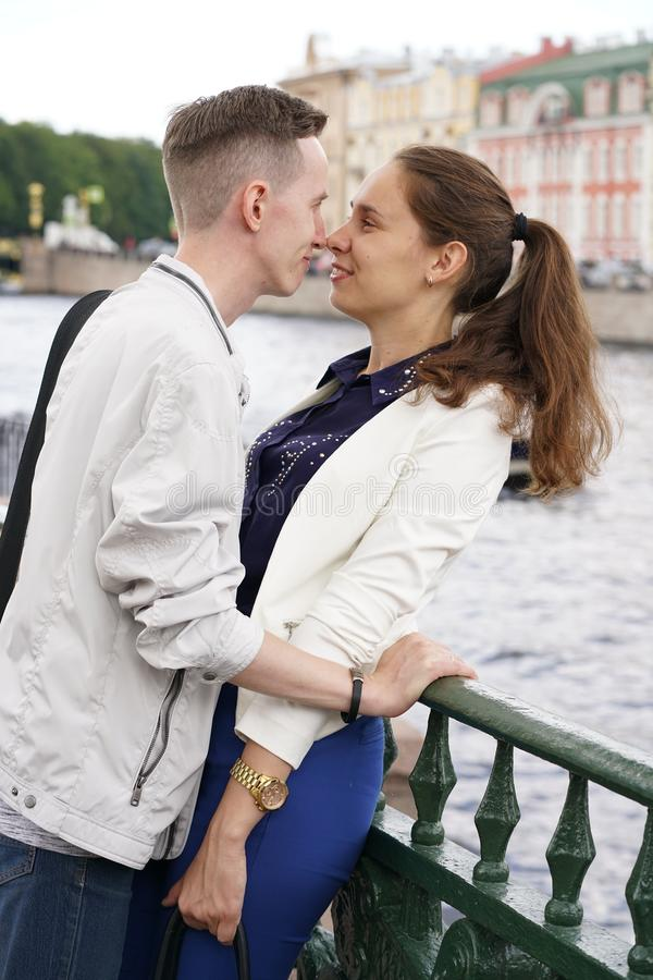 Charming good couple husband and wife walking around the city, hugging and spending time with love. Together stock photos