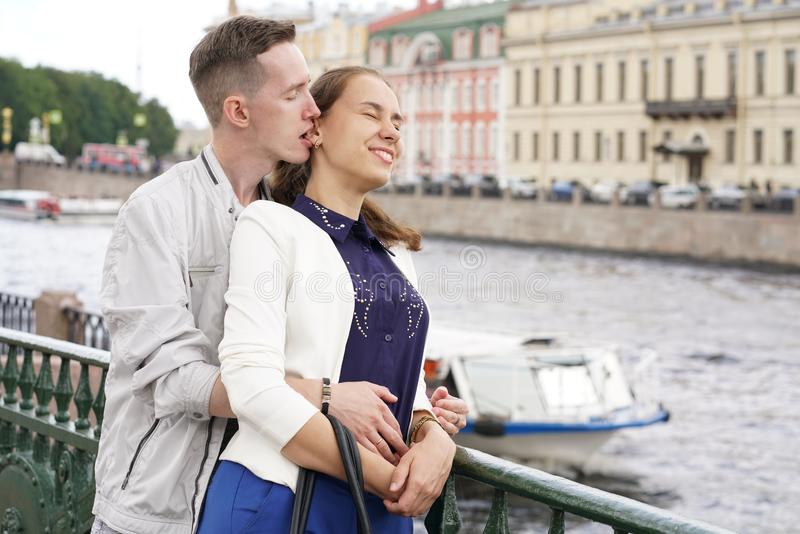 Charming good couple husband and wife walking around the city, hugging and spending time with love. Together royalty free stock photography