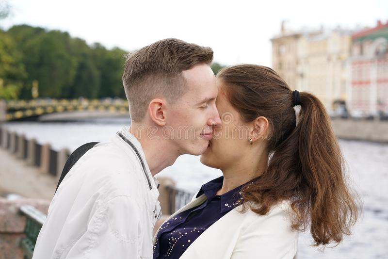 Charming good couple husband and wife walking around the city, hugging and spending time with love. Together royalty free stock image