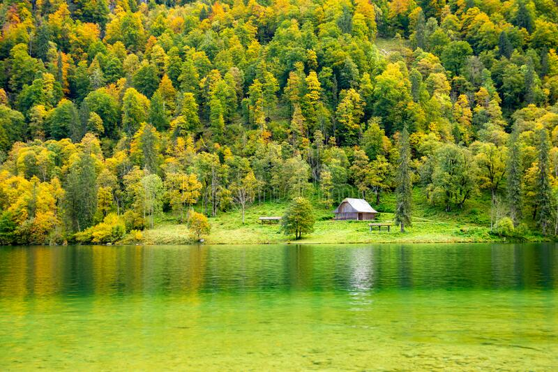 Charming hut on Lake Konigssee during autumn in Berchtesgaden in Bavaria Germany royalty free stock photo