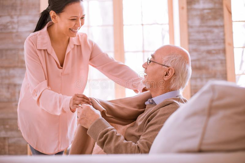 Charming international woman helping her mature patient royalty free stock images