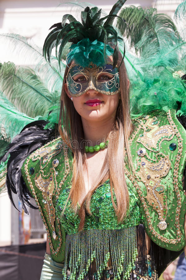 Charming italian woman in Venetian green costume mask dress stock images