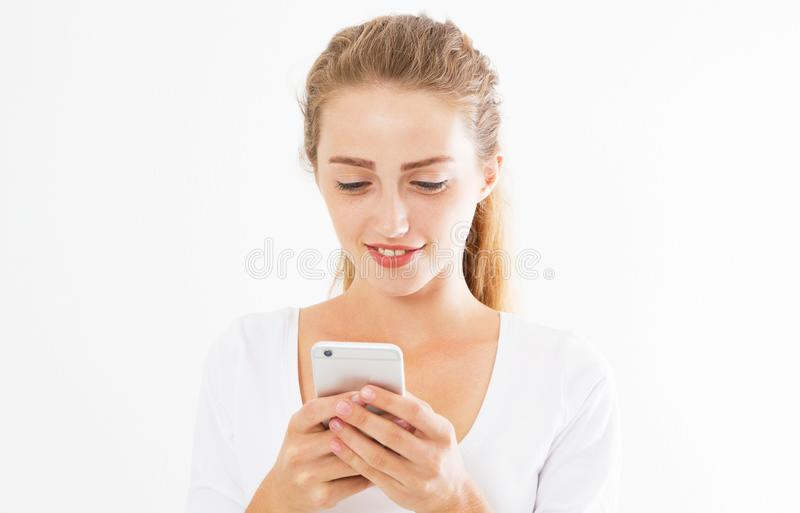 Charming joyful girl is reading pleasant text message on mobile phone from her boyfriend during her rest time. Smiling royalty free stock images