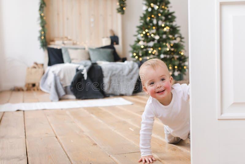 Charming kid in doorway of cozy bedroom stock photography