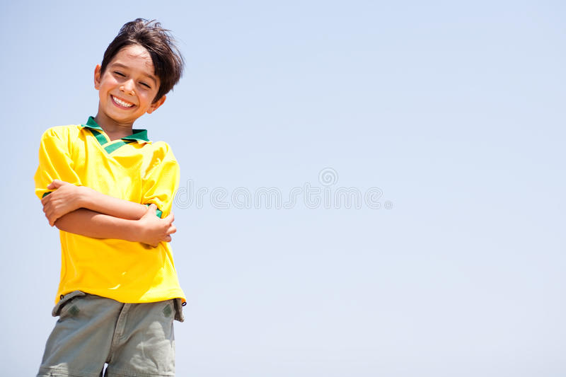 Charming kid posing with folded arms royalty free stock photos