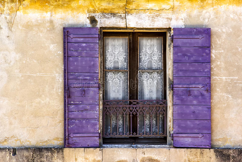 Charming Lace Curtained Window in Old Wall royalty free stock photo