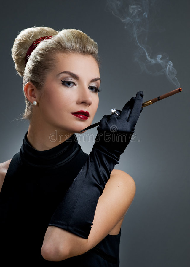 Charming Lady Smoking Cigarette Stock Image