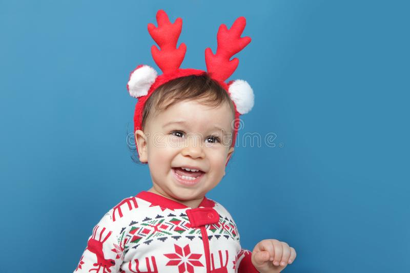 Charming little boy in Christmas pajamas stock images