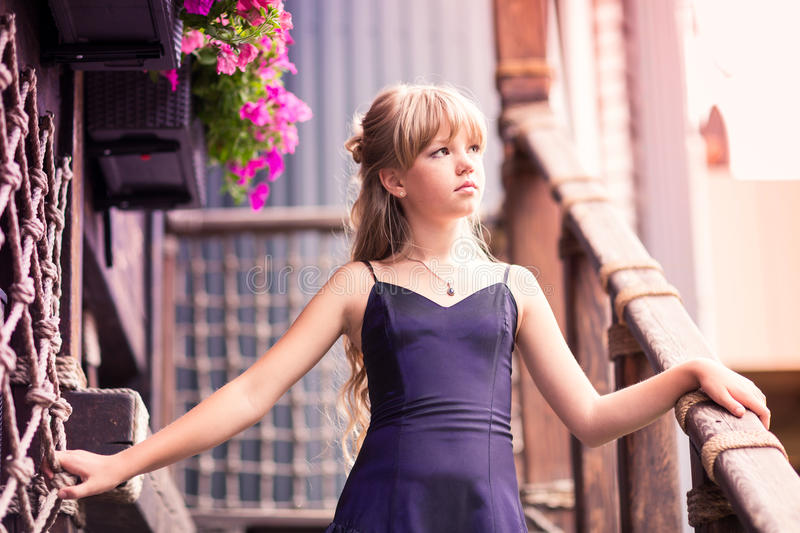 Charming little girl in a beautiful dress outdoor. Charming little girl in a beautiful dress in a park outdoor stock photo