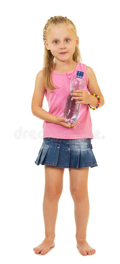 Charming little girl with bottle of water isolated on white. Background royalty free stock photos