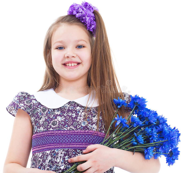 Charming little girl with a bouquet of flowers. stock photography