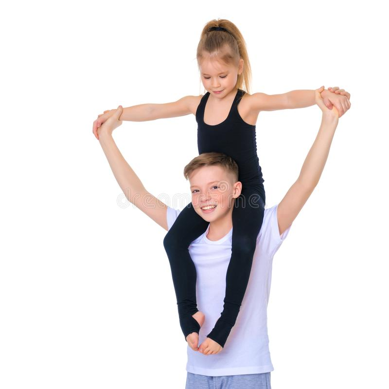 Brother and sister embrace. stock photos
