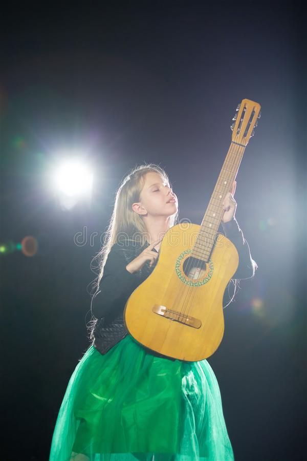 Charming little girl performs at a solo concert stock photos