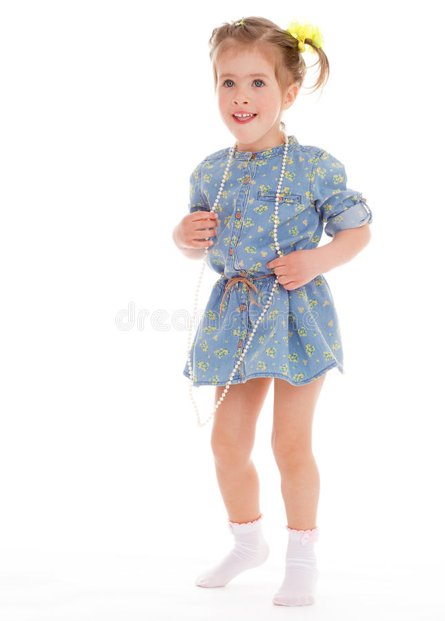 Charming little girl playing and having fun. royalty free stock photography