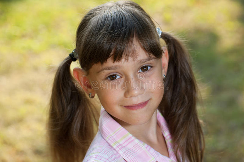 Download Charming Little Girl With Tails Royalty Free Stock Images - Image: 26199499