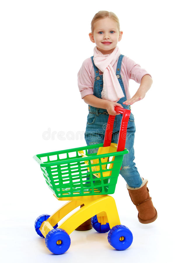 Charming little girl with a toy truck. royalty free stock images