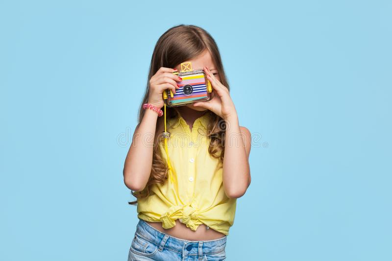 Little girl posing with photo camera stock photography