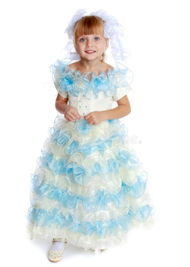 Little princess in a long dress. stock photo