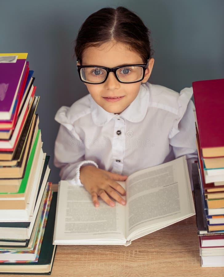 Charming little school girl stock photography