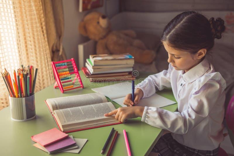 Charming little school girl stock photos