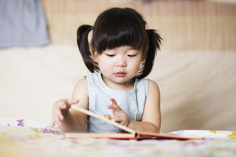 Charming and lovely asian kid reading book. Charming and lovely asian kid reading book royalty free stock photo