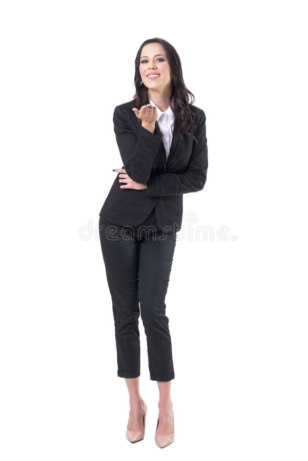 Charming lovely elegant business woman smiling and sending kiss at camera. Full body isolated on white background stock image