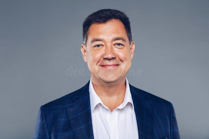 Charming Mature confident business man on suit and white shirt,dressed well studio portrait. royalty free stock photos
