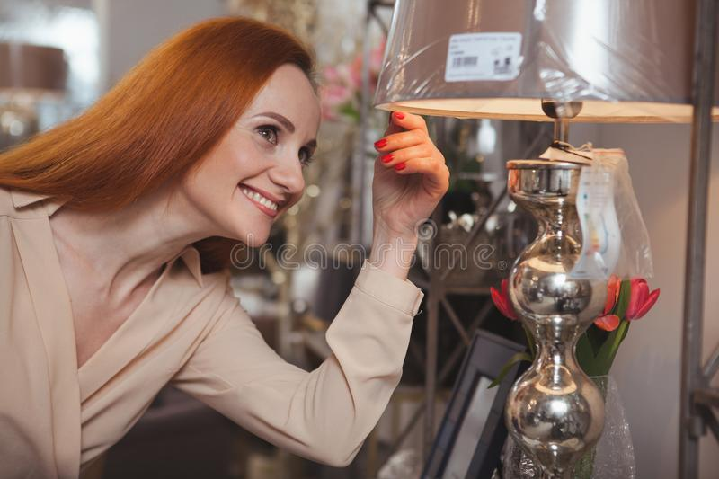 Charming woman enjoying shopping at home decor store royalty free stock photography