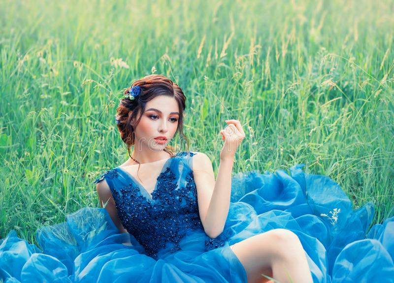 Charming mysterious story about porcelain doll, lovely girl in long blue lush delicate dress. lady with dark braided royalty free stock photos