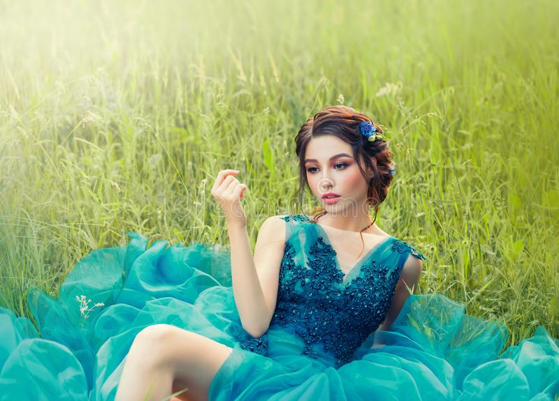 Charming mysterious story about porcelain doll, lovely girl in long blue lush delicate dress. lady with dark braided stock photo