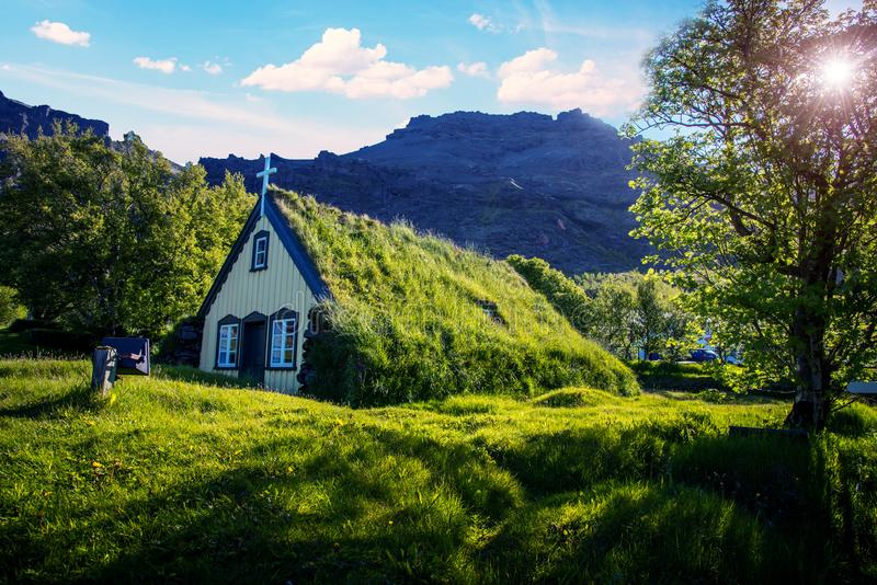 Charming mystical scene with turf roof church in old Iceland traditional style and mystical cemetery in Hof, Skaftafell,. Vatnajokull National Park. Exotic stock image
